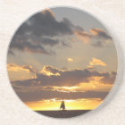 Sail boat at sunset coaster