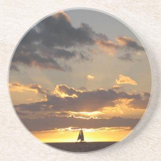 Sail boat at sunset coaster