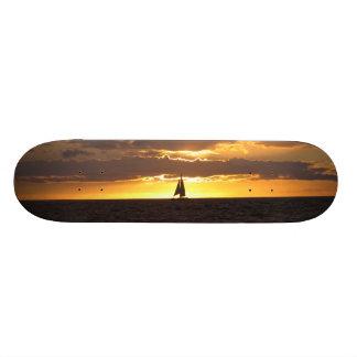 Sail boat at sunset skateboard