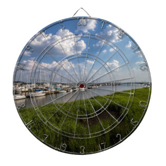 Sailboat Marina and Lush Green Grassland Dartboard With Darts