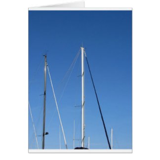 Sailboat masts in the marina against a blue sky card