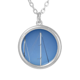Sailboat masts in the marina against a blue sky silver plated necklace