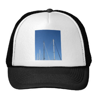 Sailboat masts in the marina against a blue sky trucker hat