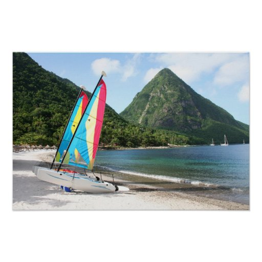 Sailing Boat and water sports equipment on a beach Poster