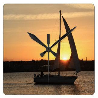 Sailing in Cardiff Bay at Sunset. Square Wall Clock