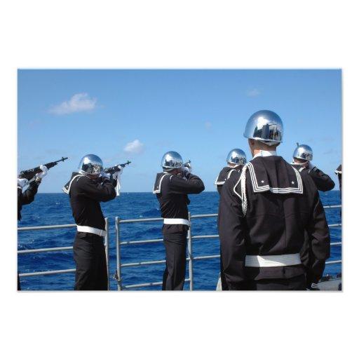 Sailors fire a gun salute during a burial-at-se photo art
