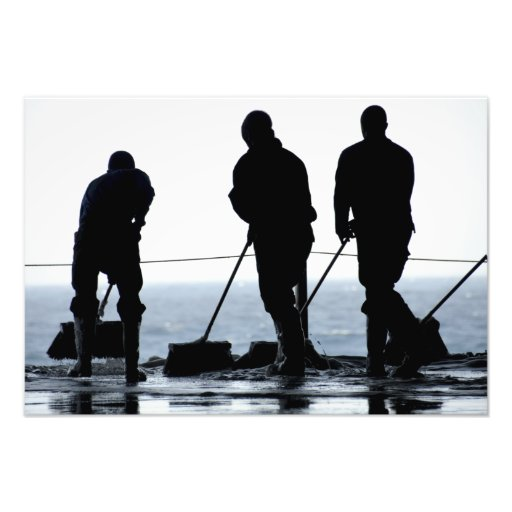 Sailors sweep out the hangar bay photo