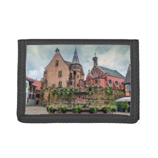 Saint-Leon fountain in Eguisheim, Alsace, France Tri-fold Wallets