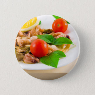 Salad of blanched pieces of seafood on a plate 2 inch round button
