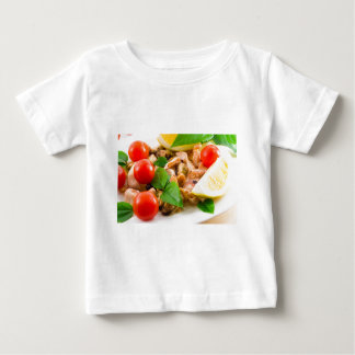 Salad of blanched pieces of seafood on a plate baby T-Shirt