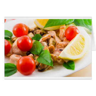 Salad of blanched pieces of seafood on a plate card