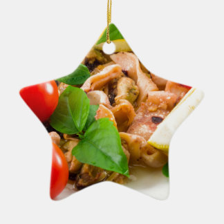 Salad of blanched pieces of seafood on a plate ceramic ornament