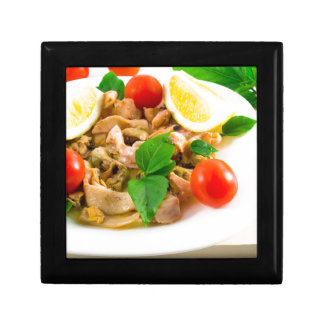 Salad of blanched pieces of seafood on a plate gift box