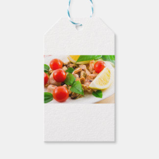 Salad of blanched pieces of seafood on a plate gift tags
