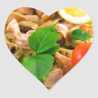 Salad of blanched pieces of seafood on a plate heart sticker