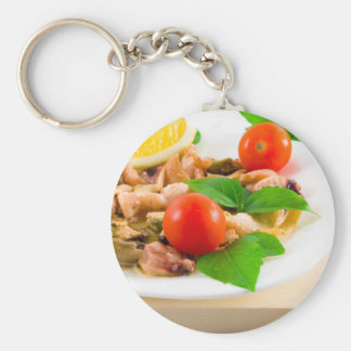 Salad of blanched pieces of seafood on a plate keychain