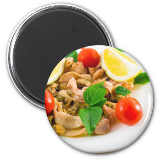 Salad of blanched pieces of seafood on a plate magnet