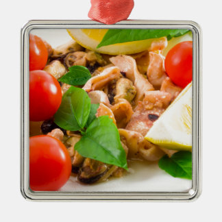 Salad of blanched pieces of seafood on a plate metal ornament