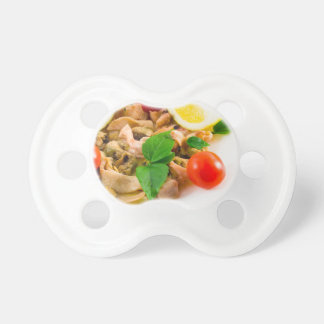Salad of blanched pieces of seafood on a plate pacifiers