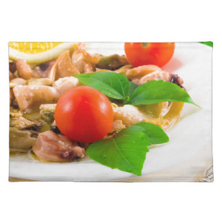 Salad of blanched pieces of seafood on a plate placemat