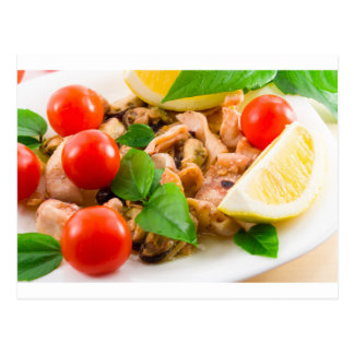 Salad of blanched pieces of seafood on a plate postcard