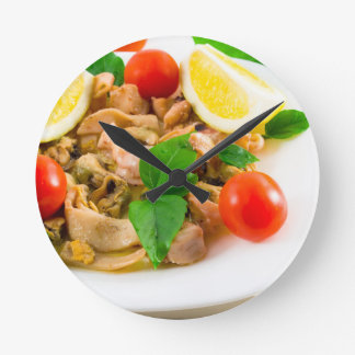 Salad of blanched pieces of seafood on a plate round clock
