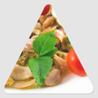 Salad of blanched pieces of seafood on a plate triangle sticker
