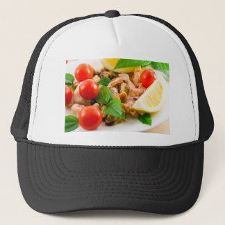 Salad of blanched pieces of seafood on a plate trucker hat
