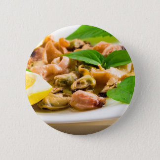 Salad of blanched seafood on a white plate 2 inch round button