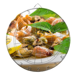 Salad of blanched seafood on a white plate dartboard