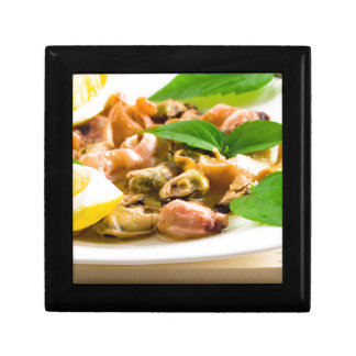 Salad of blanched seafood on a white plate gift box