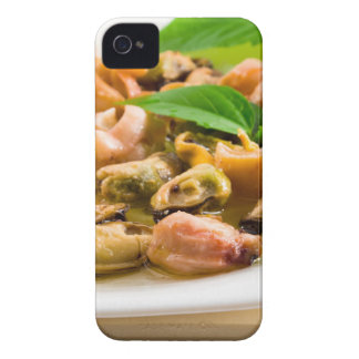 Salad of blanched seafood on a white plate iPhone 4 covers