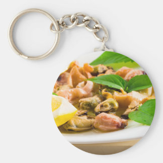 Salad of blanched seafood on a white plate keychain