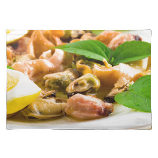 Salad of blanched seafood on a white plate placemat