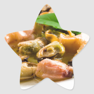 Salad of blanched seafood on a white plate star sticker