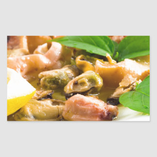 Salad of blanched seafood on a white plate sticker