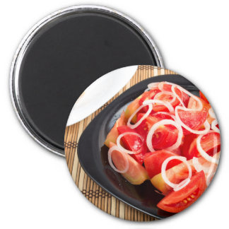 Salad of red and yellow tomato 2 inch round magnet
