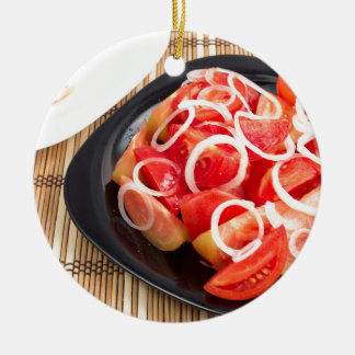 Salad of red and yellow tomato round ceramic ornament