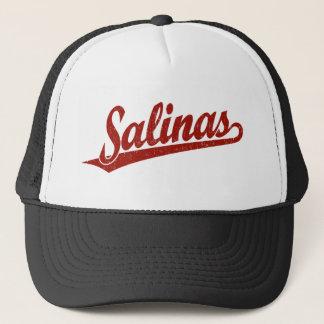 Salinas script logo in red distressed trucker hat