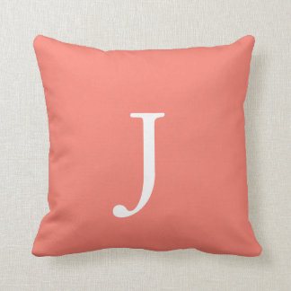Salmon colored monogram throw pillow