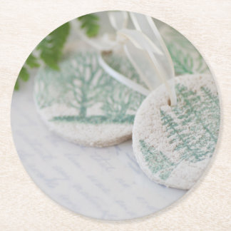 Salt dough tree ornaments on vintage letters round paper coaster