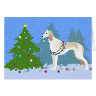 Saluki decorating a Christmas tree in the forest Card
