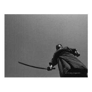 Samurai warrior standing, holding a swoard 2 postcard