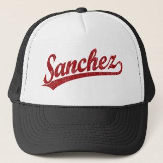 Sanchez script logo in red trucker hat