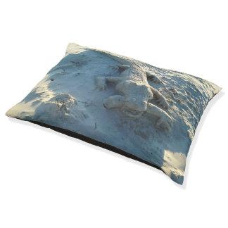 Sand art alligator holding human arm. pet bed