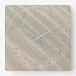 SAND CLOCK. SANDY BEACH, COVERED IN SAND, CLOCK