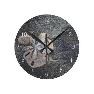 Sand dollar on sand round clock