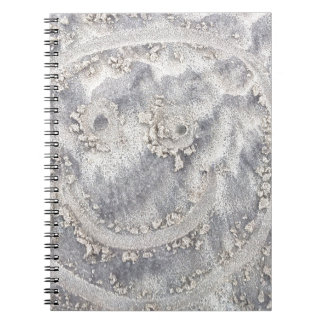 Sand drawing. Sunny smiley face on the beach Notebook