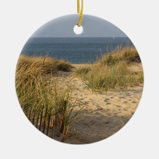 Sand dune, dune grass, and beach fence round ceramic ornament