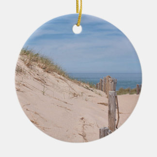 Sand dunes and beach fence round ceramic ornament